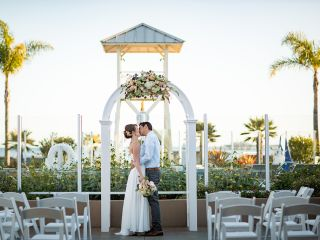 Couple kisses under beautiful wedding arch at Avila Lighthouse Suites wedding venue