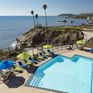 Largest heated oceanfront pool in Pismo Beach overlooks the bluffs and gazebo at Shore Cliff Hotel