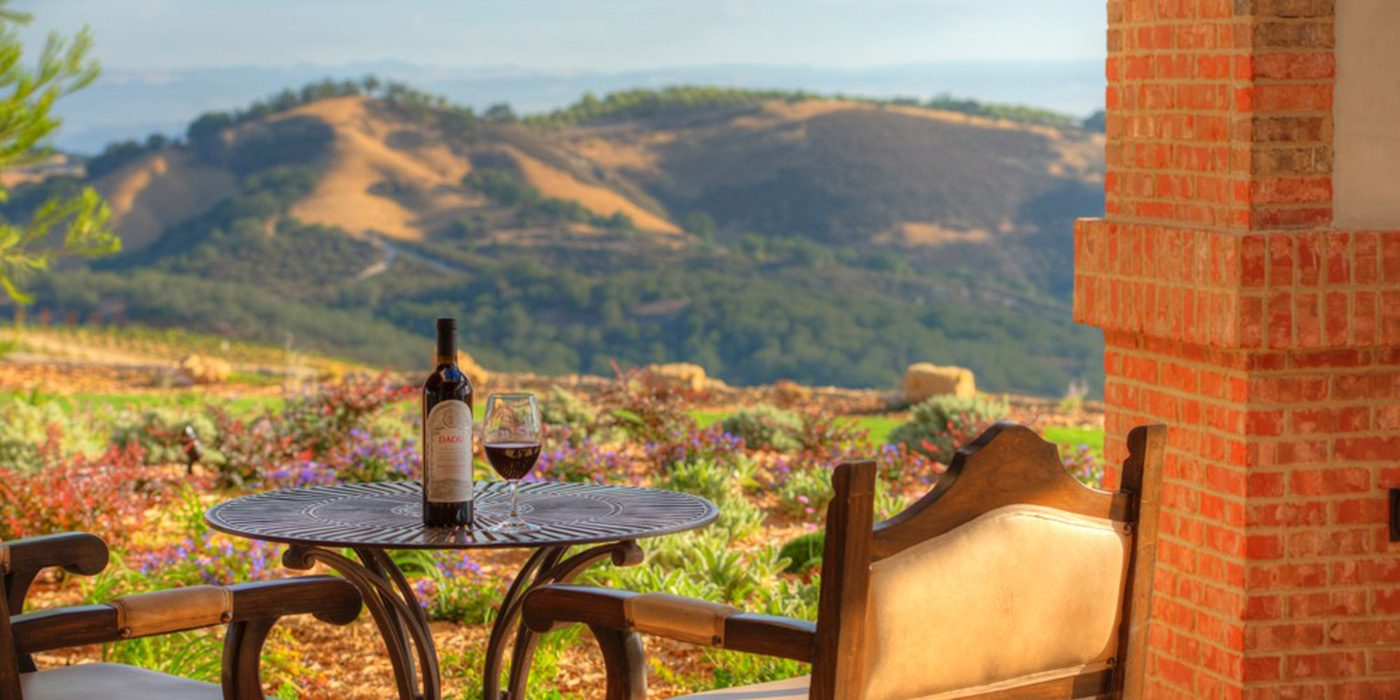 Enjoy a glass of red wine with a view of Paso Robles rolling hills