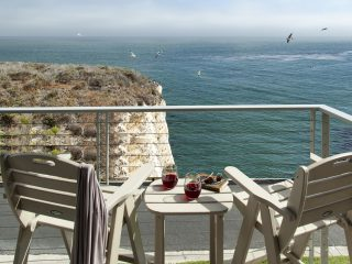 Balcony set up for two at beachfront Pismo hotel